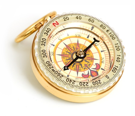 old styled, gold compass on a white background  photo