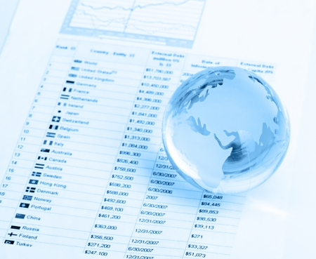 Glass globe and pen on finance background photo