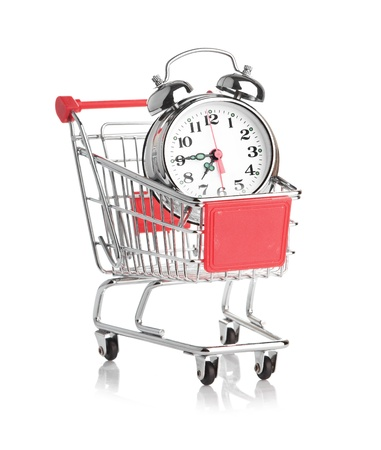 buying time: Buying time concept with clock and shopping cart Stock Photo