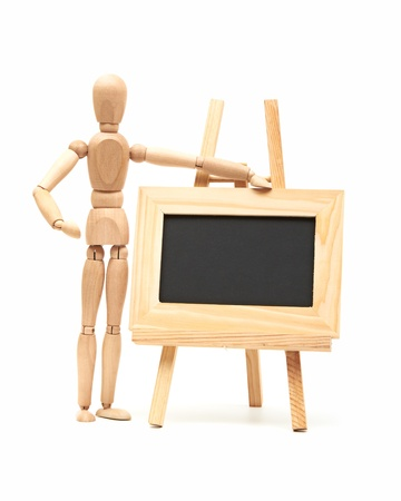Wooden concept of mannequin in pose with wood frame Stock Photo - 15031834
