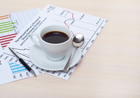 Accounting. Cup of coffee on document. chart and diagram photo