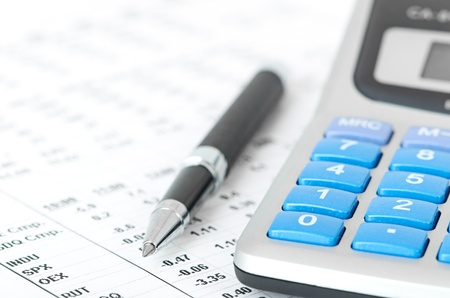 bringing: pen and calculator on a chart background Stock Photo