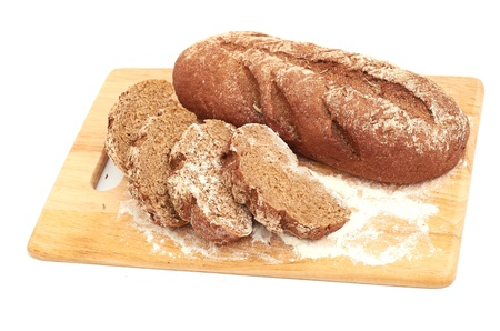 Fresh bread with ear of wheat isolated on white photo