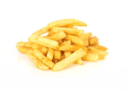fatty food: a pile of french fries isolated on white
