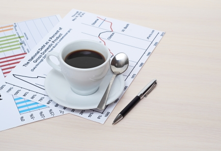 Accounting  Cup of coffee on document  chart and diagram photo