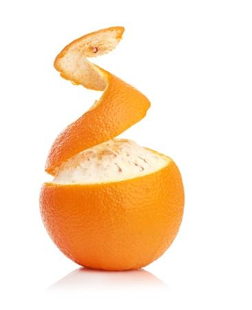 tangerine peel: orange with peeled spiral skin isolated on white background