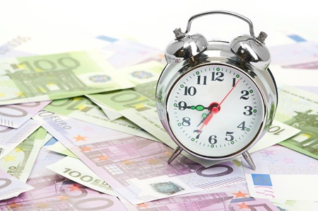 Alarm clock for euro banknotes photo