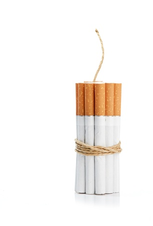 Cigarettes tied with rope and wick isolated on white photo