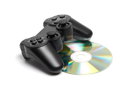 Game Pad and a CD isolated on a white background photo