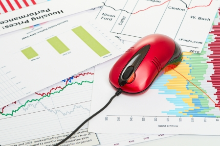 financial graph with computer mouse photo