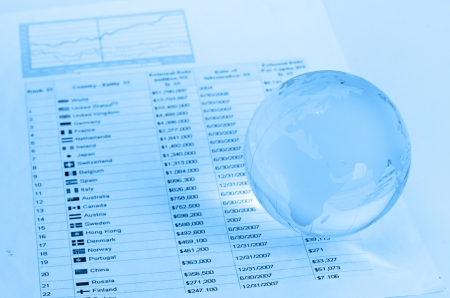 Glass globe and pen on finance Stock Photo - 16157496