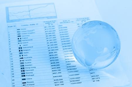 Glass globe and pen on finance Stock Photo - 16157496
