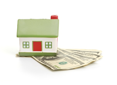Model of a house lying on some banknotes Stock Photo - 16157270