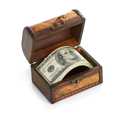 American Dollar-bills in the old wooden treasure chest, isolated on white photo