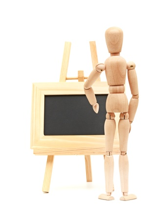 Wooden concept of mannequin in pose with wood frame Stock Photo - 16288450