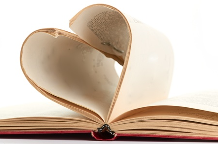 pages of a book curved into  heart Stock Photo - 17002826