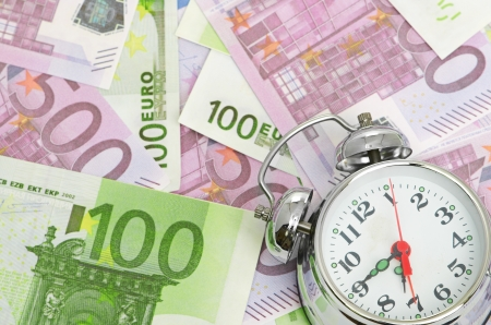 euro banknote: Alarm clock for euro banknotes Stock Photo