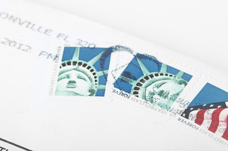 usps: USA- CIRCA 2011  Postage stamp printed in USA shows the image of the Statue of Liberty   USA FIRST CLASS FOREVER WITH HAPPY HOLIDAYS