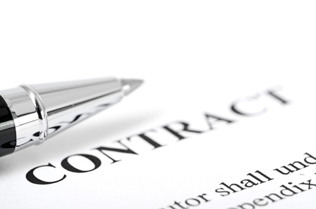 sign contract: Close-up of silver pen on contract
