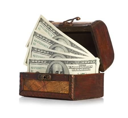 Dollar-bills in the old wooden treasure chest photo