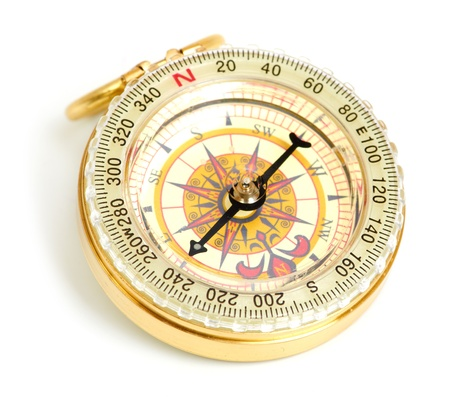 old styled, gold compass isolated on white background photo