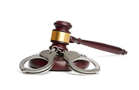 A pair of handcuffs and gavel are isolated for legal concepts  Stock Photo - 17158193