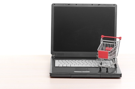 Online shopping  trolley on laptop Stock Photo - 17174965