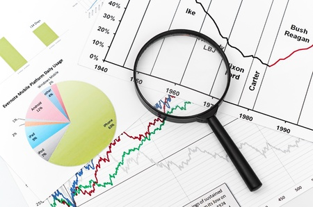 magnifying glass on graph business search Stock Photo - 17551596