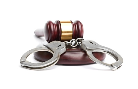 A pair of handcuffs and gavel Stock Photo - 17551286
