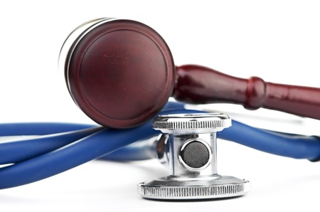brown gavel and a medical stethoscope on white background Stock Photo - 17551563
