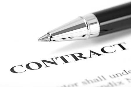 legal document: Close-up of silver pen on contract