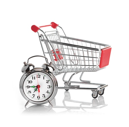 Buying time concept with clock and shopping cart Stock Photo - 17551341