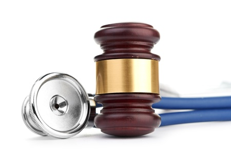 brown gavel and a medical stethoscope on white background Stock Photo - 17694874