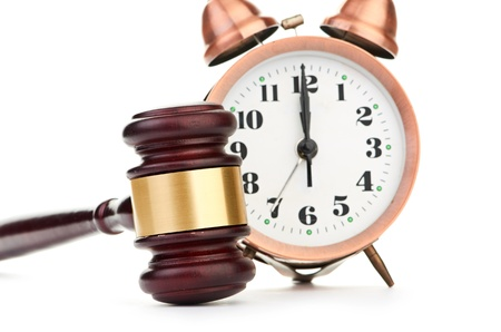 Gavel and old clock Stock Photo - 17694885