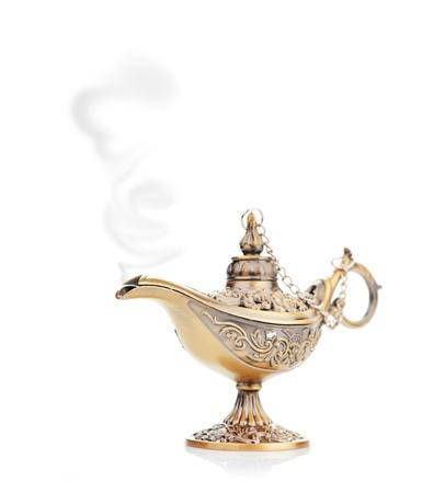 Aladdin magic lamp isolated on white photo