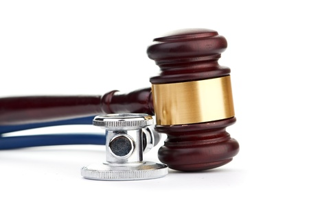 brown gavel and a medical stethoscope Stock Photo - 18191298