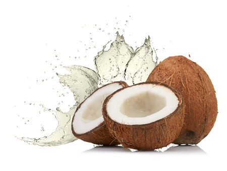 cracked coconut with splashing water Stock Photo