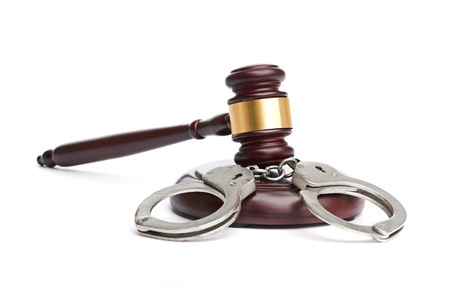 A pair of handcuffs and gavel Stock Photo - 18324611