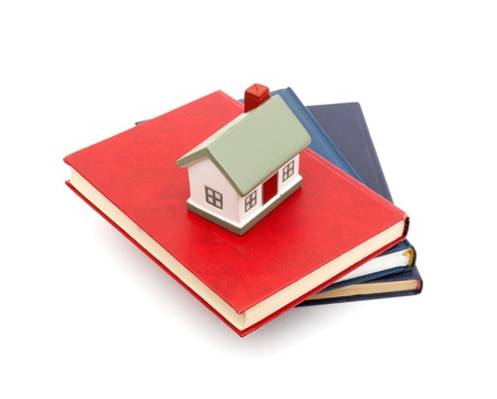 little house and books isolated on white background Stock Photo - 18688654