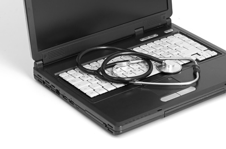 computer concept with stethoscope on laptop, photo