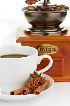 coffee beans with wooden coffee grinder and coffee cup  photo