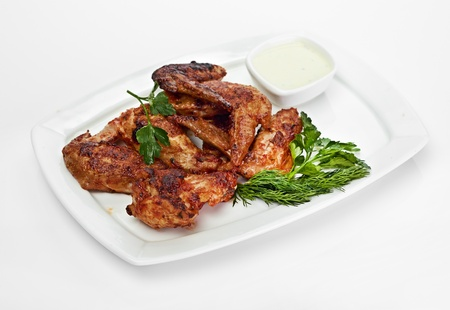 Hot Meat Dishes - Grilled Chicken Wings with Red Spicy Sauce photo