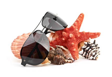sun glasses on sea star and shell photo