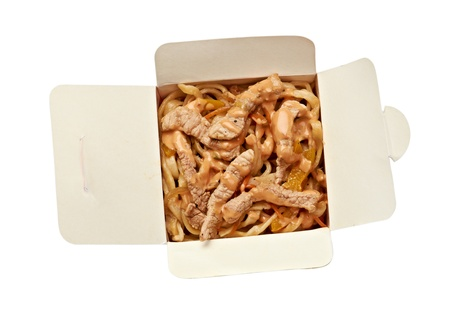Noodles with pork and vegetables in take-out box on white background photo