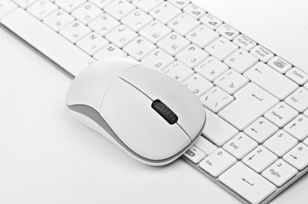 White computer mouse on the keyboard Stock Photo - 21254538
