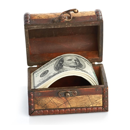 Dollar-bills in the old wooden treasure chest Stock Photo