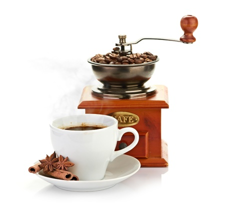 coffee beans with wooden coffee grinder and coffee cup. photo