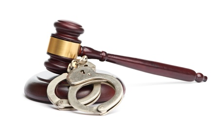 A pair of handcuffs and gavel Stock Photo - 21931844