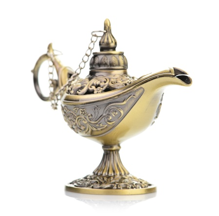 Aladdin magic lamp isolated on white photo