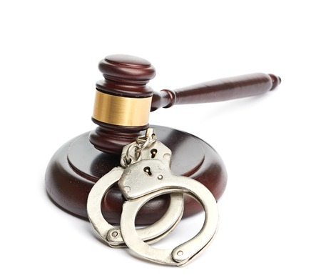 handcuffs and gavel Stock Photo - 22397460